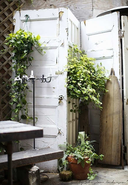 salvage doors hinged together for a patio privacy screen - Emily Johnston Anderson via Atticmag
