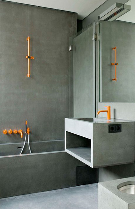 modern concrete bath with orange Vola shower and sink fixtures - kaleidoscopeblog via atticmag