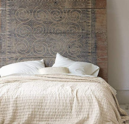 wall mounted headboards - wood plank headboard with Vitruvian scoll incising – Eileen Fisher via Atticmag