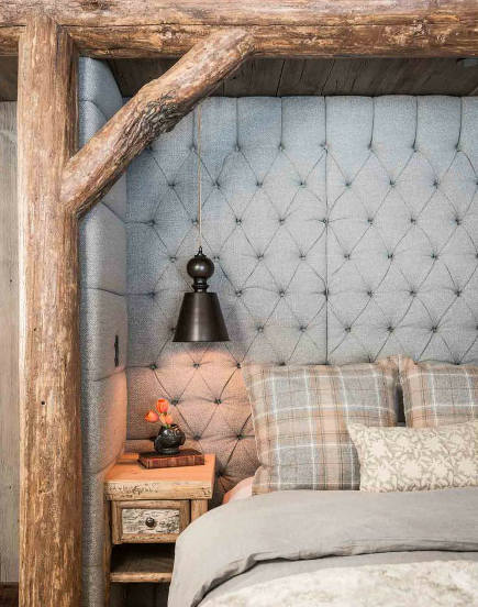 country bedrooms - fabric-upholstered bed niche framed by hickory timbers - Pearson Design Group via Atticmag