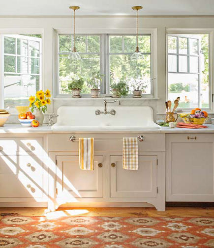 white kitchen with orange home decor in an Oriental print runner – thisoldhouse via atticmag