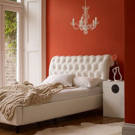 bedroom with burnt orange accent wall – housetohome via atticmag