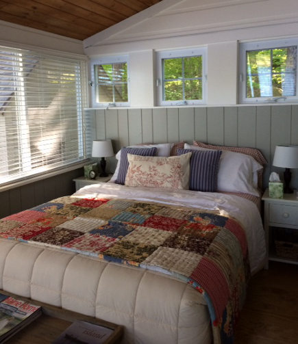 guest bedroom in a Maine Lake Camp house - Atticmag