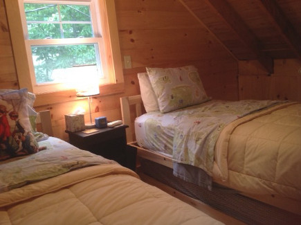 twin-bedded, pine-paneled sleeping loft in a Maine Lake Camp house - Atticmag