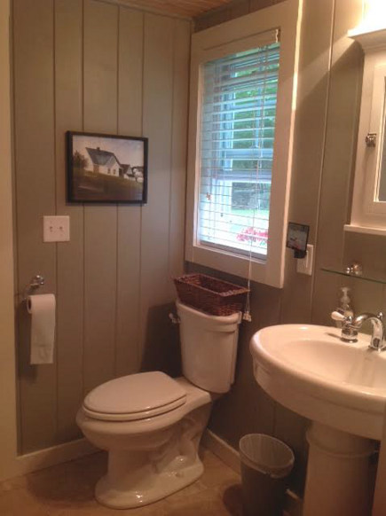 Maine Lake Camp bathroom with American Standard fixtures -- Atticmag