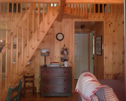 pine paneled great room of a Maine lake camp house - Atticmag