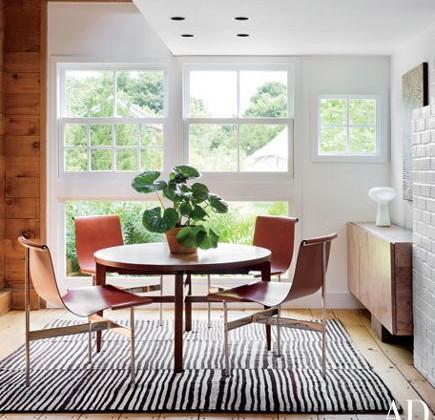 mid-century zebra print kilim in a dining space – AD via Atticmag