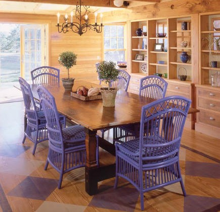 blue painted furniture in the dining room of a Massachusetts beach house - hutker architects via atticmag