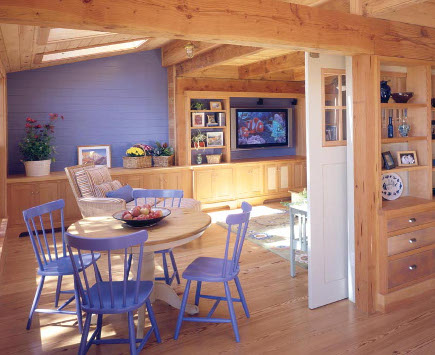 blue painted furniture and accent wall in the sitting room of a Massachusetts beach house - hutker architects via atticmag