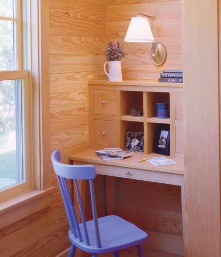 blue painted furniture at a small desk in a Massachusetts beach house- hutker architects via atticmag