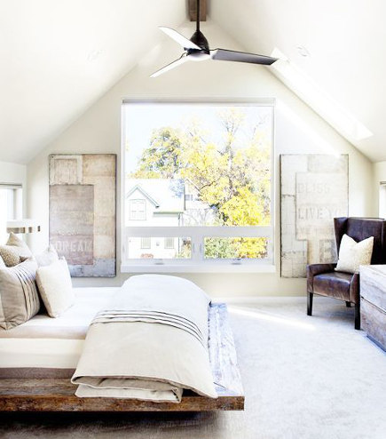 attic bedroom accent wall - master bedroom with a picture window - meridian105 via atticmag