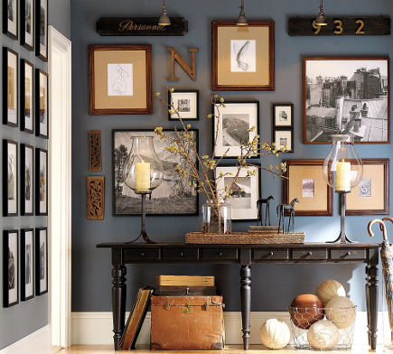 hallway picture walls - photos on dark background with objects - potterybarn via atticmag