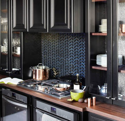 all black kitchen of the year for 2014 by Steven Miller - Whirlpool gas cooktop, Gold Wall Ovens and Kraftmaid Onyx cabinets - house beautiful via atticmag
