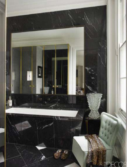 black and white decor - black and white marble bathroom with pale blue upholstered chair by Colin Radcliffe - Elle Decor via Atticmag