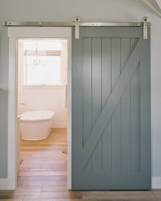 bathroom barn doors - gray painted half-buck wood slider on the hallway  side of