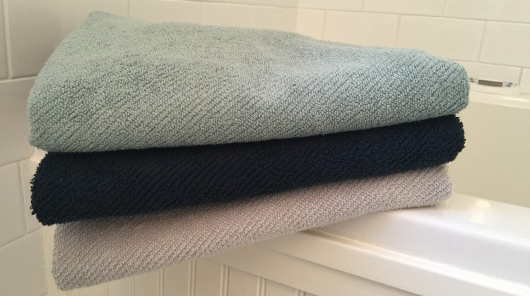 buying bath towels - Coyuchi Twill Weave Air Weight towels in mid dusty aqua, midnight and fog - Atticmag