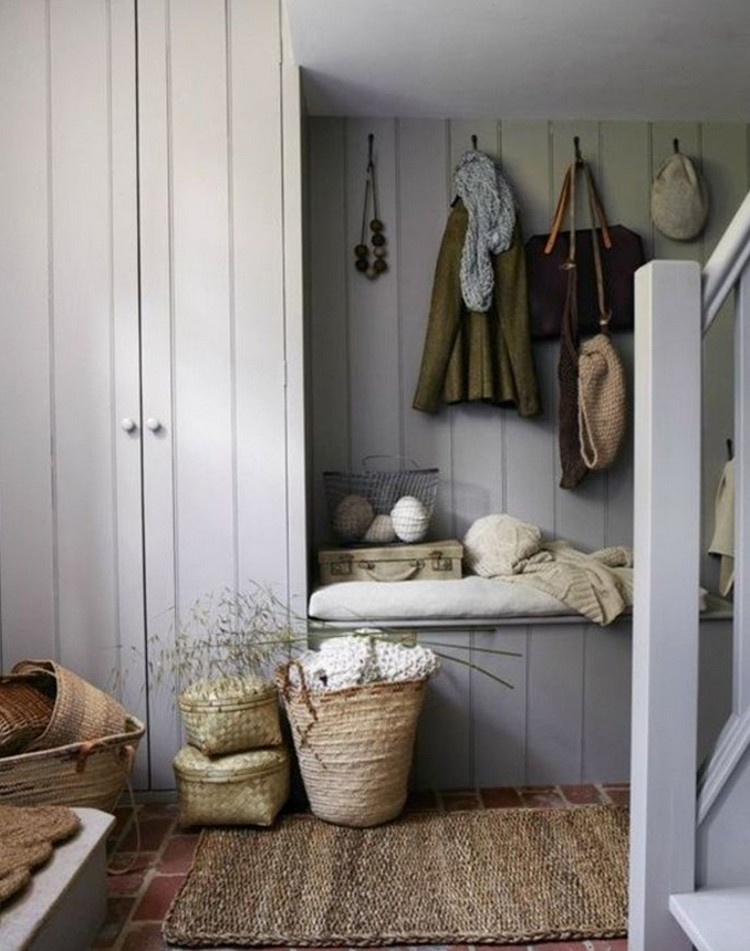 colorful mudrooms - mudroom hallway with brick paver floor and gray-painted planked woodwork in a color similar to BM Excalibur Gray - Country Living via Atticmag
