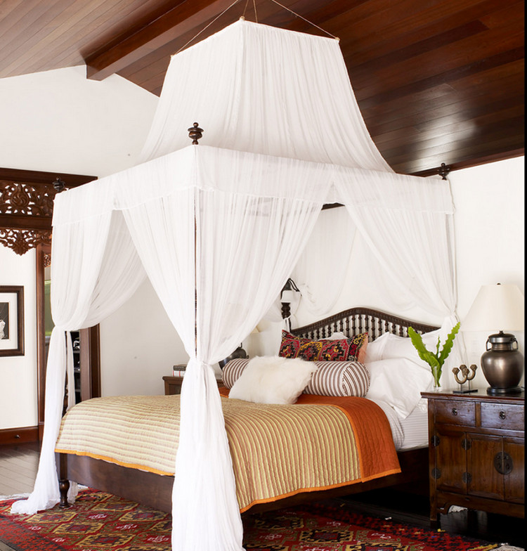 bedrooms - white draped canopy bed in a South Seas inspired bedroom - Martin Lawrence Bullard via Atticmag