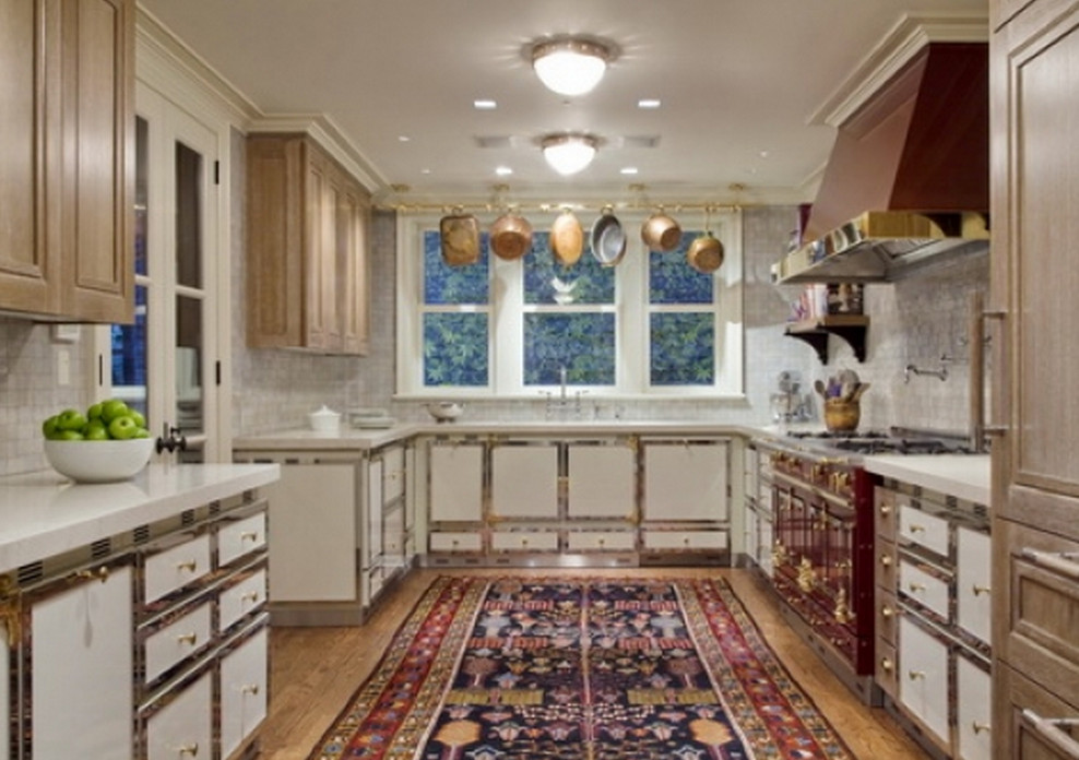kitchen carpets- room size Oriental rug in a red and white La Cornue kitchen  -