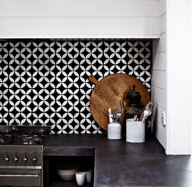 geometric tile - Petit White Fleur tile backsplash from Jatana Interiors -  hgtvdecor via atticmag - Geometric Tile Kitchen Backsplash - Atticmag