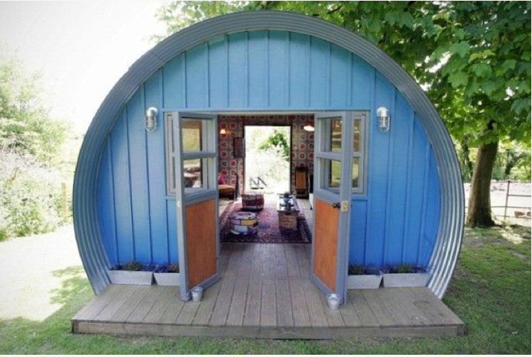 backyard shed - blue Nissan hut entertaining shed with wallpaper and furniture - Telegraph.co.uk via Atticmag