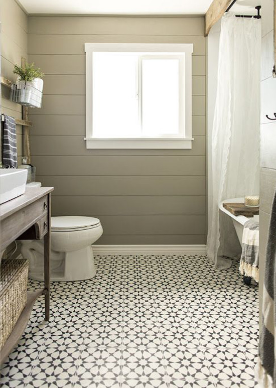 bathroom floor tile - patterned Moroccan-inspired black and white bathroom floor tile in a redone tone-on-tone guest bath - Jenna Sue Design via Atticmag