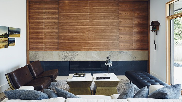 flat screen - Toronto living room with a walnut cabinet disguising a television over the fireplace - Dwell via Atticmag