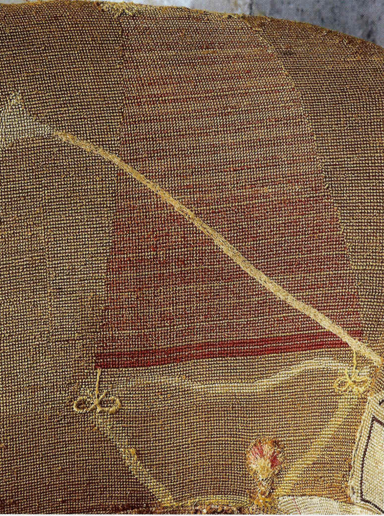 detail of upside down tasselled bag on antique George III needlepoint sofa with asymmetrical back - WOI via atticmag