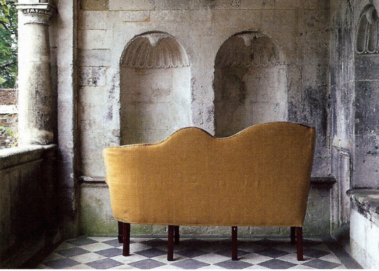 silhouette of restored back of antique George III needlepoint sofa with asymmetrical back - WOI via atticmag