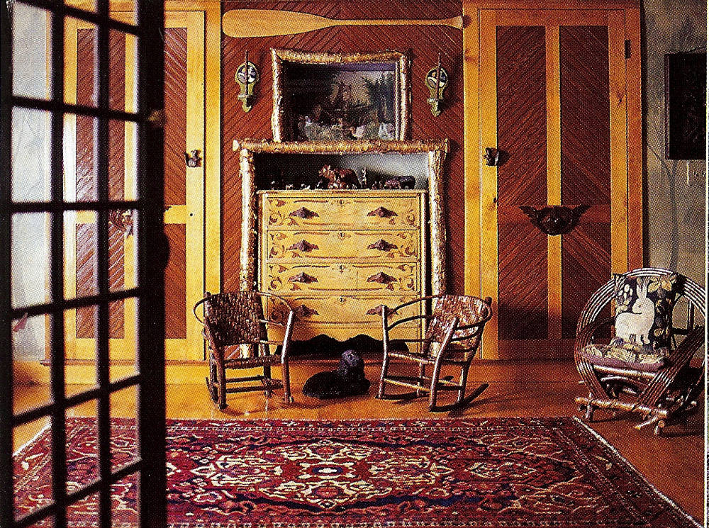 fishing camp - yellow painted Victorian chest in a niche framed by split logs in a hallway - Country Living via Atticmag