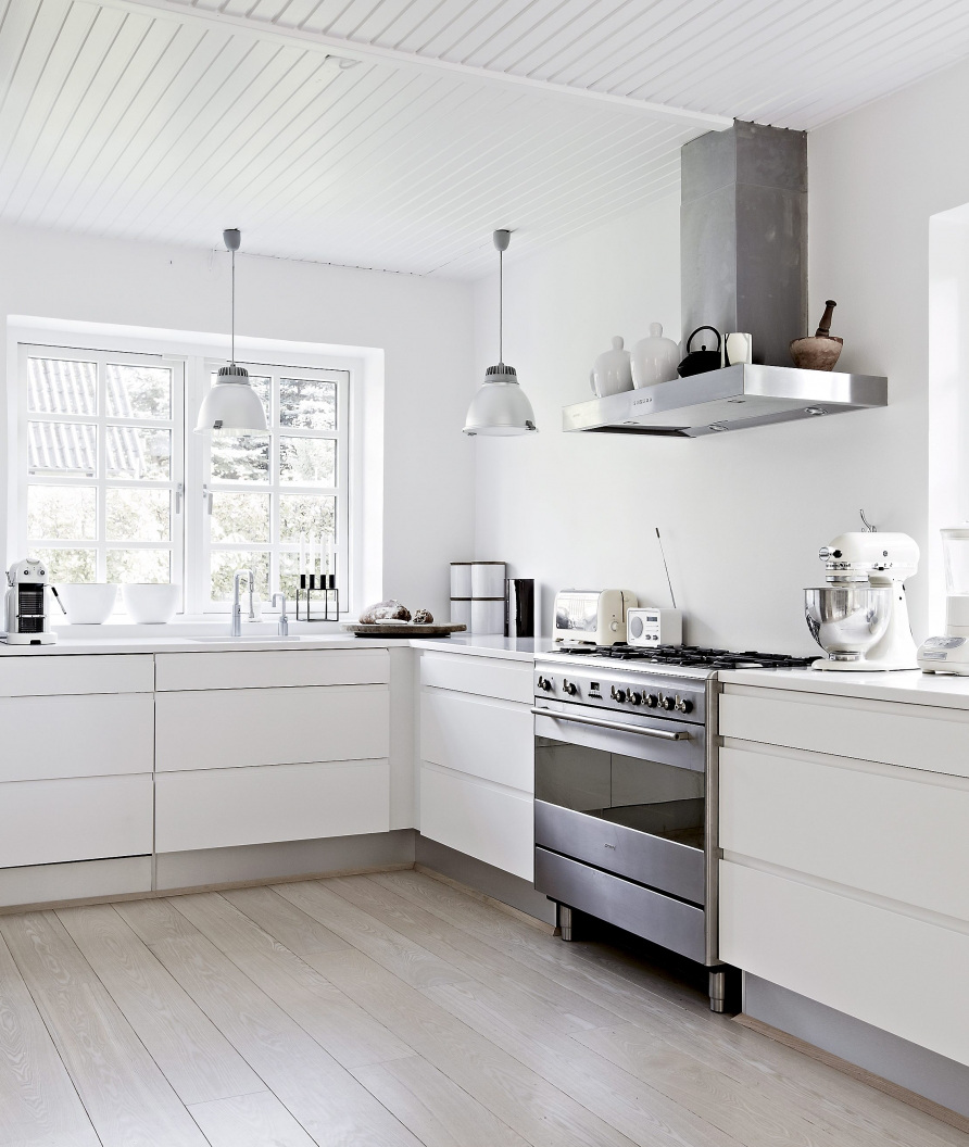 Nordic color kitchens - modern white kitchen with natural wood floor - femina.dk via atticmag