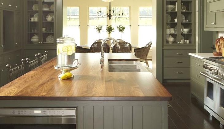 bottle green kitchens - transitional bottle green kitchen with cream and natural wood accents - Kohler home ideas via atticmag