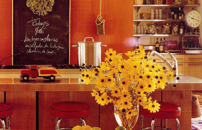 orange kitchens - orange walled caterer's kitchen in Mexico - Met Home via Atticmag