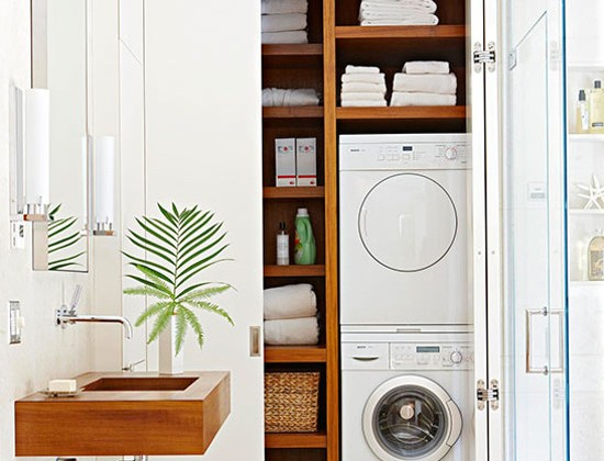 laundry room features - master bathroom laundry closet with stacked European front loaders - bh & g via Atticmag