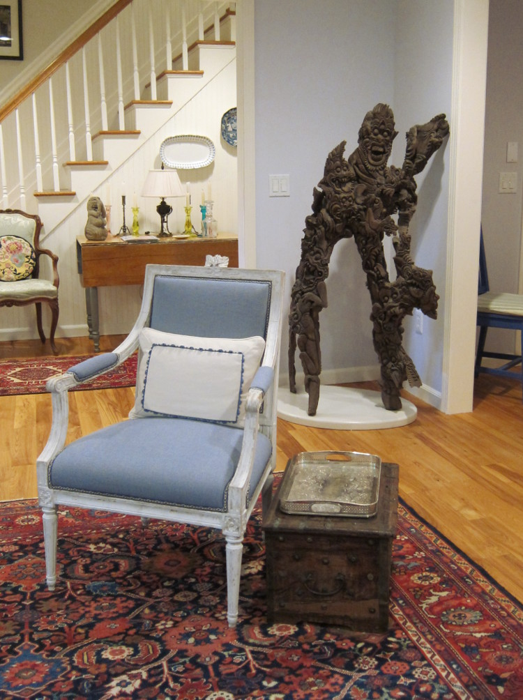 my house - the Balinese sculpture from our apartment in its new home in the living room behind the Swedish Gustavian chair - Atticmag