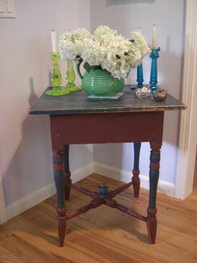 my house - antique Swedish painted table in its original corner with American candlesticks and pottery - Atticmag