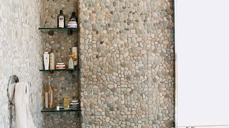 all over natural pebble tile shower and bath - domino via Atticmag.com