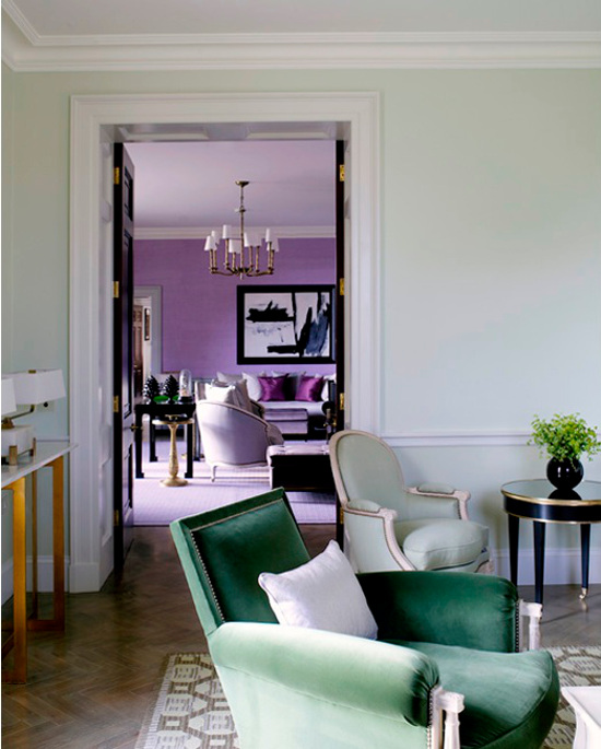 lavender - tone-on-tone lavender living room framed by a white painted doorway and seen from a mint green room - House & Garden via Atticmag.com