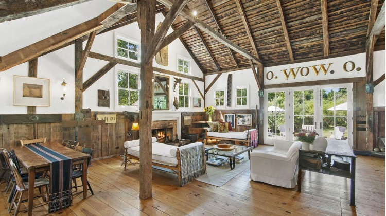 barn living rooms - Long Island barn living room with brick fireplace and wide plank pine floor - Brown Harris Stevens via Atticmag