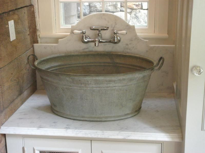 elegance married to utility is an ideal union in this handsome washtub sink laundry room