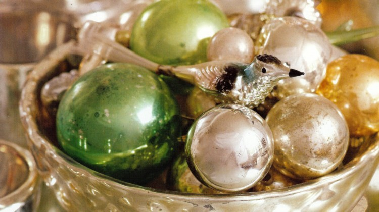 Christmas palette — silver, gold and green ornaments in a mercury glass container - Veranda via Atticmag
