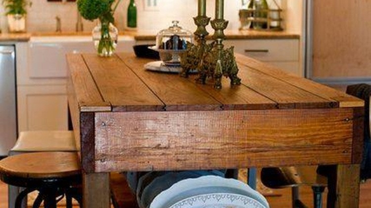 kitchen island storage - open dish storage shelves on the end of a marble top island - pinterest via atticmag