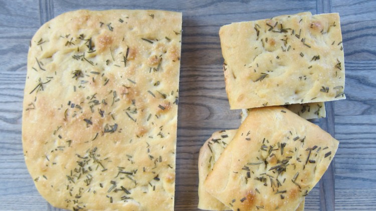 rosemary focaccia - baked salted rosemary focaccia whole and cut - Atticmag