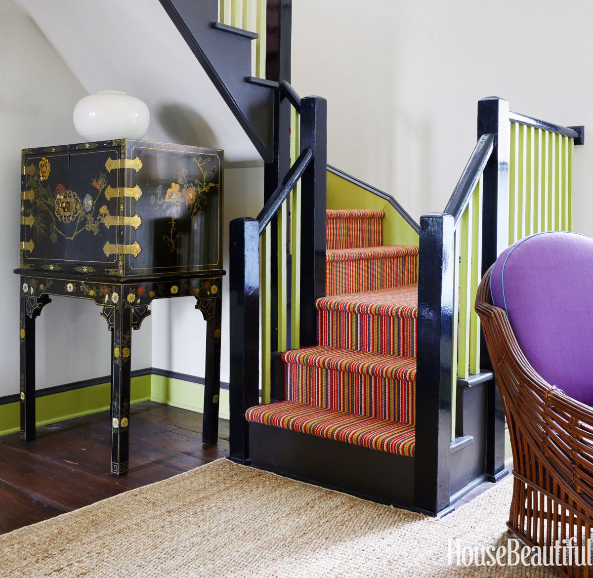 crayola colored woodwork - staircase in a house by Jeffrey Bilhuber with red carpet, chartreuse balusters and gray posts - House Beautiful via Atticmag