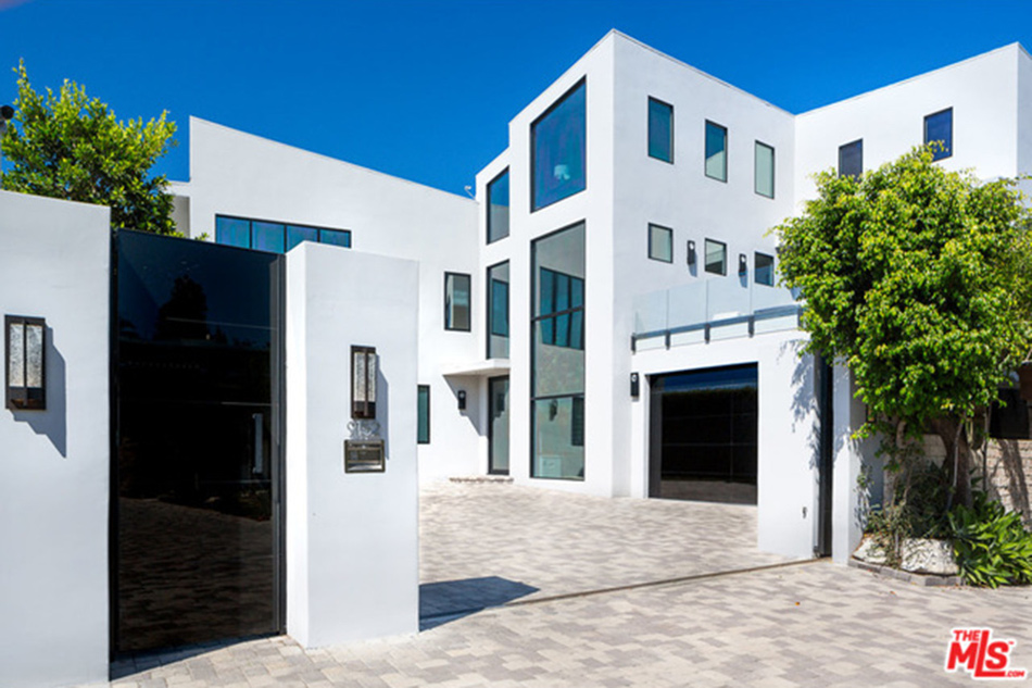 modern mansion exterior entrance of beverly hills home designed by kirk nix purchased by chrissy