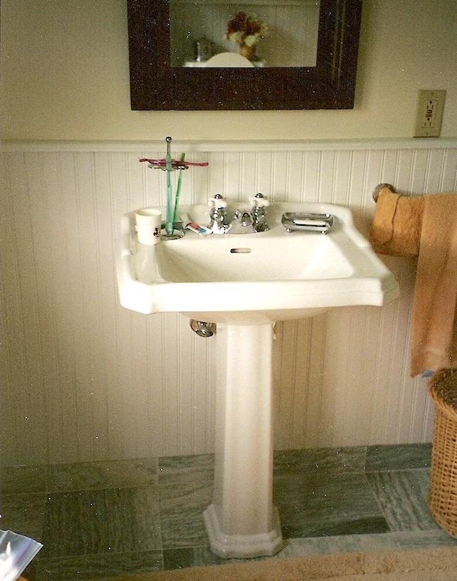 seafoam guest bath - Vermont cottage guest bath with white beadboard, white pedestal sink and green marble floor - Atticmag