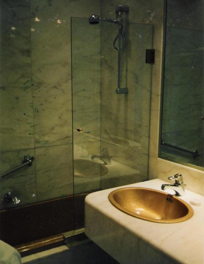seafoam bath - glass shower guard on an Ultra Bain air jet tub in a guest bath - Atticmag