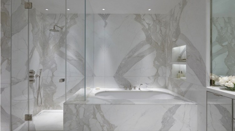 white marble bathroom - tub and shower wall of statuario veneto minimalist bath - Todhunter Earle Interiors via Atticmag