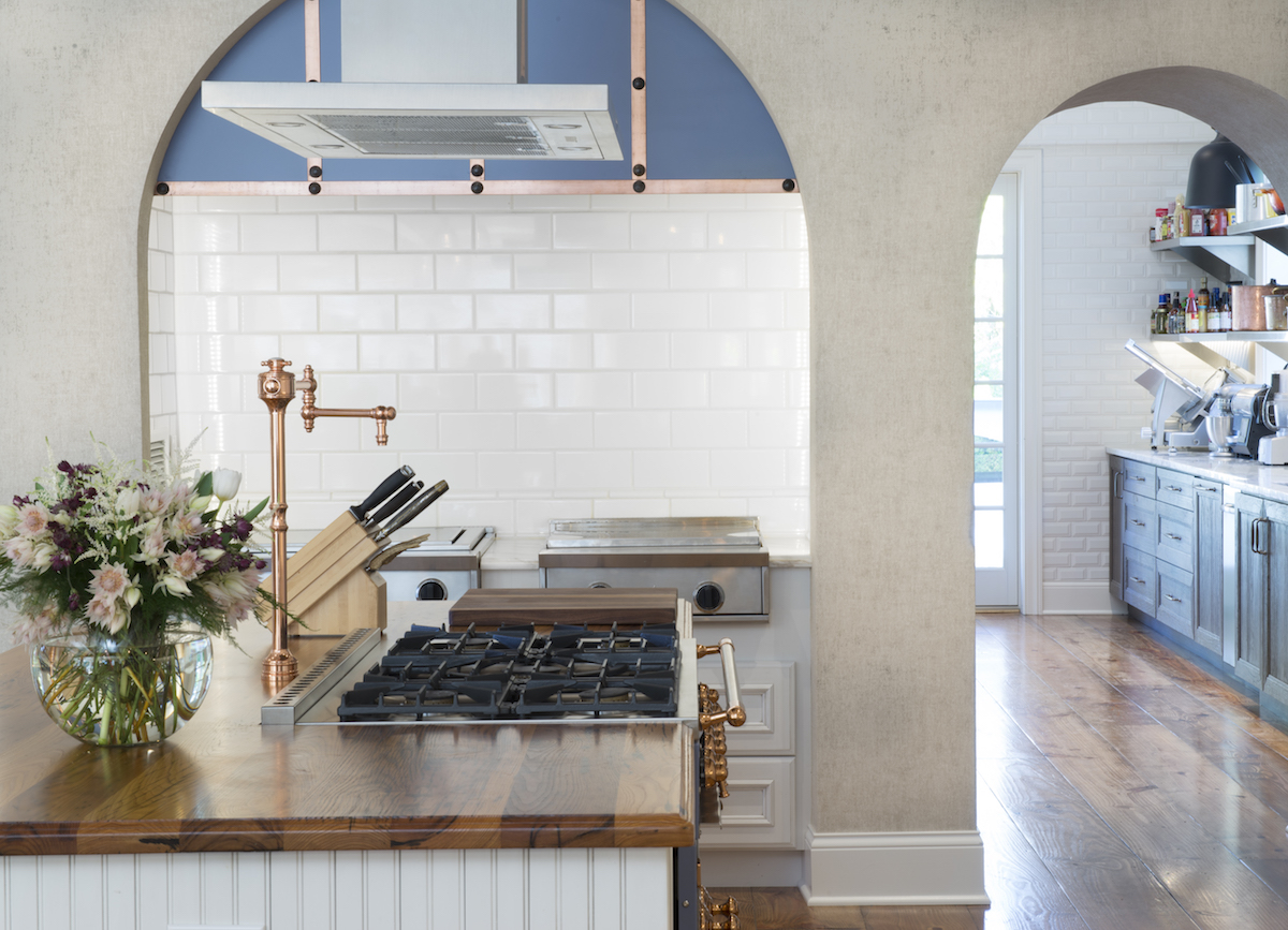 two kitchens - white DuraSupreme cabinet kitchen with Provence blue CornueFé range and hood by Jenny Rausch - Karr Bick Kitchens via Atticmag