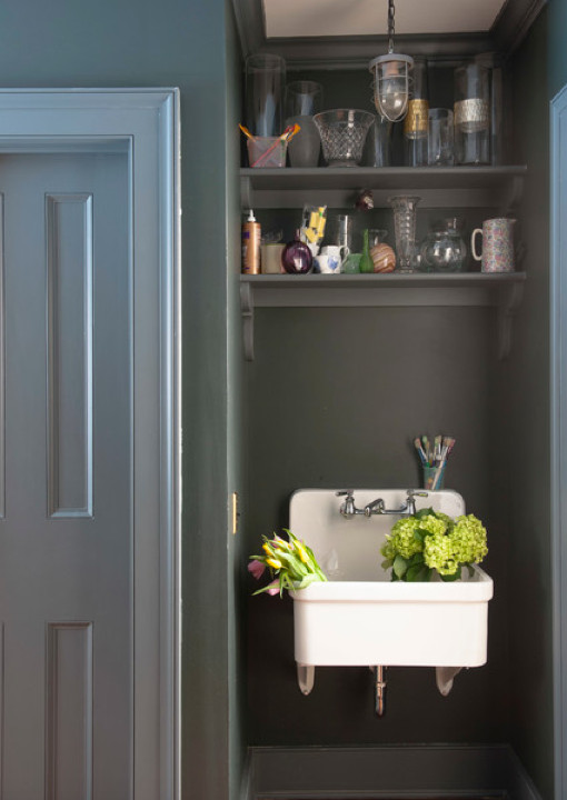 laundry room sinks - small Kohler Gilford hanging in a dark painted wall niche - Rafe Churchill via Atticmag